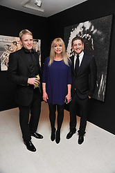 Left to right,  JAMIE WOOD, JO WOOD and TYRONE WOOD at a private view of Russell Young's work entitled American Envy held at Scream Gallery, 34 Bruton Street, London on 7th April 2011.