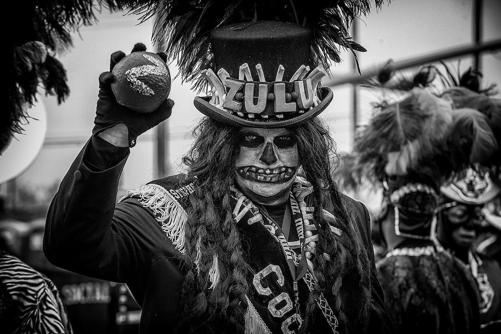 Zulu Tramp Stephen Rue holds up a hand-painted coconut, the most sought after throw in the Zulu Social Aid & Pleasure Club's 'Zulu Parade' on Jackson Avenue, the first parade on the morning of Mardi Gras Day on February 12, 2013 in New Orleans, Louisiana.