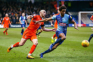 Wycombe Wanderers defender Sido Jombati holds off Luton Town midfielder Alan McCormack during the EFL Sky Bet League 1 match between Luton Town and Wycombe Wanderers at Kenilworth Road, Luton, England on 9 February 2019.