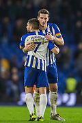 Neal Maupay (Brighton) & Lewis Dunk (Capt) (Brighton) hug while thanking the Brighton & Hove Albion FC supporters following the 2-2 draw at the Premier League match between Brighton and Hove Albion and Wolverhampton Wanderers at the American Express Community Stadium, Brighton and Hove, England on 8 December 2019.