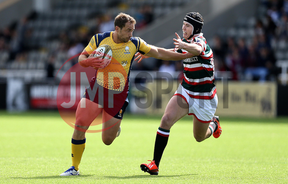 Jaike Carter of Worcester Warriors hands off Charlton Kerr of Leicester Tigers - Mandatory by-line: Robbie Stephenson/JMP - 30/07/2016 - RUGBY - Kingston Park - Newcastle, England - Worcester Warriors v Leicester Tigers - Singha Premiership 7s