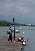Plovdiv, Bulgaria, {DATE, }FISA, Rowing World Cup 1,  Ekaterina KARSTEN, BLR, W1X, right, prepares to go on water, as Coach holds Sculls[© Karon PHILLIPS/ Intersport Images]