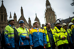 © Licensed to London News Pictures. 28/10/2015. London, UK. TATA Steel workers erect a banner in front of The Houses of Parliament in London to demonstrate against the decline in the British steel industry and recent closures of steel plants in the UK.  Photo credit: Ben Cawthra/LNP