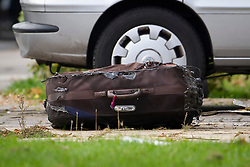 ©  London News Pictures. 15/10/2012. Harlow, UK. A burnt suitcase lying on the floor outside a property on Barn Mead, Harlow, Essex where three children and a woman have died and three others are in hospital following a house fire. Two boys aged 13 and six, a girl aged 11 and the woman were declared dead at the scene. A nine-year-old boy and a three-year-old girl have serious burns and a man has minor burns. Photo credit : Ben Cawthra/LNP