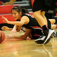 101615  Adron Gardner/Independent<br /> <br /> Gallup Bengal Martina Smiley (3) dives around Grants Pirate Christina Moleres (3) for a loose ball at Grants High School Friday