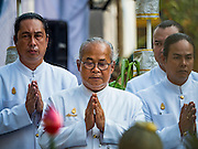 """19 DECEMBER 2016 - BANGKOK, THAILAND:  Royal Court Brahmin priests pray during the """"Spirit Appeasing"""" Ceremony held for the Royal Chariots at the Bangkok National Museum. The chariots will be used to take the body of Bhumibol Adulyadej, the Late King of Thailand, and members of the Royal funeral cortege to the cremation site on Sanam Luang for His Majesty's cremation. This will be the first cremation of a Thai King since 1950, when King Bumibol's brother, Rama VIII, Ananda Mahidol, was cremated. The design of the royal crematorium is based on Buddhist cosmology, with the main peak of Mount Sumeru (also known as Meru in Hindu cosmology) at center and eight other peaks signifying the levels of the universe. The crematorium will be decorated with mythical creatures such as garuda, angels, and Himmapan Forest creatures. The structure and funeral pyre will stand just over 50 meters tall. The exact date of the King's cremation has not been set yet but is expected to be late next year.    PHOTO BY JACK KURTZ"""