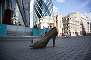 Discarded high heel shoe in the City of London, near to The Gerkhin. Sign that a night out went a liitle crazy.
