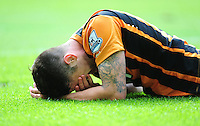 Hull City's Robbie Brady lays on the ground after challenging Manchester United's Luis Antonio Valencia for the ball<br /> <br /> Photographer Chris Vaughan/CameraSport<br /> <br /> Football - Barclays Premiership - Hull City v Manchester United - Sunday 24th May 2015 - Kingston Communications Stadium - Hull<br /> <br /> © CameraSport - 43 Linden Ave. Countesthorpe. Leicester. England. LE8 5PG - Tel: +44 (0) 116 277 4147 - admin@camerasport.com - www.camerasport.com