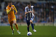 Brighton & Hove Albion winger Jamie Murphy (15) and Preston North End midfielder Paul Gallagher (12) during the EFL Sky Bet Championship match between Brighton and Hove Albion and Preston North End at the American Express Community Stadium, Brighton and Hove, England on 15 October 2016.