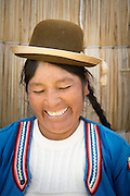 Native Uru woman on the Floating islands of Lake Titicaka, Puno, Peru, South America