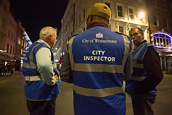 Licensed to London News Pictures. 24/09/2020. London, UK. City inspectors patrol the streets of Soho in central London on the first day of the 10PM curfew comes into force. Prime Minister Boris Johnson has announced new measures to attempt to reduce the rising number of new Covid-19 infections. Photo credit: Marcin Nowak/LNP