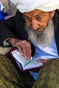 Old man studying the Quoran, Shrine of Khwaja Abd Allah, Herat, Afghanistan