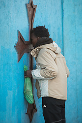 October 23, 2016 - Calais, Calais, France - Calais , France . A worshiper arrives to attend the final day's mass at the Ethiopian Church at the camp . Dawn at the Calais migrant camp known as '' The Jungle '' , in Northern France , on the final day before the eviction and destruction of the camp  (Credit Image: © Joel Goodman/London News Pictures via ZUMA Wire)