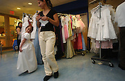 A young girl tries on a donated dress at the Pediatrics Prom at Memorial Sloan-Kettering Cancer Center in Manhattan, NY. 6/7/2005 Photo by Jennifer S. Altman