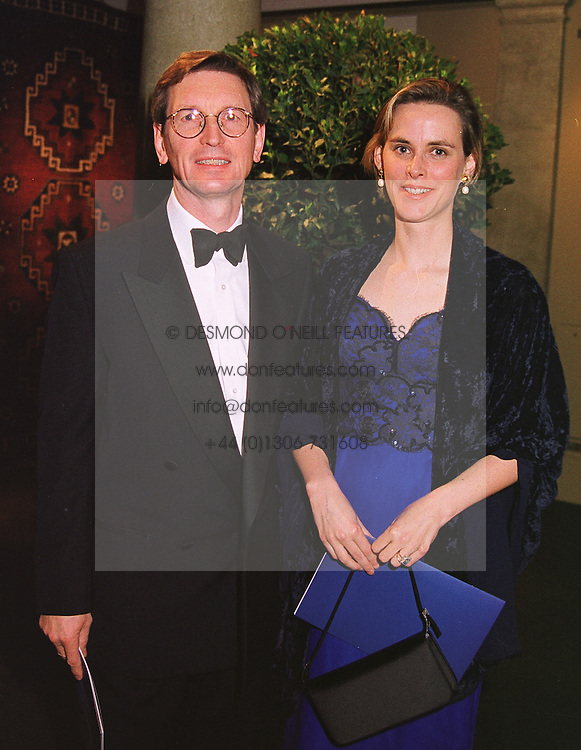 MR DAVID & the HON.MRS MONTGOMERY, she is the daughter of Lord Birdwood, at a dinner in London on 19th May 1999.MSF 63