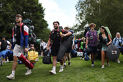 © Licensed to London News Pictures. 25/08/2021. Reading, UK. Revelers make their way to Reading Festival on a warm summers day. Warm weather is expected to greet the start of the three day music festival, twinned with Leeds Festival, attracts over 90,000 people over the bank holiday weekend. Photo credit: Ben Cawthra/LNP