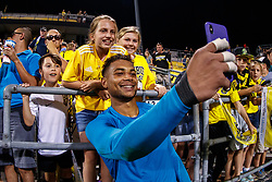 August 11, 2018 - Columbus, OH, U.S. - COLUMBUS, OH - AUGUST 11: Columbus Crew goalkeeper Zack Steffen (23) takes a selfie with young Columbus Crew fans after the MLS regular season game between the Columbus Crew SC and the Houston Dynamo on August 11, 2018 at Mapfre Stadium in Columbus, OH. The Crew won 1-0. (Photo by Adam Lacy/Icon Sportswire) (Credit Image: © Adam Lacy/Icon SMI via ZUMA Press)