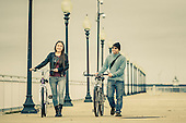 young couple with bikes