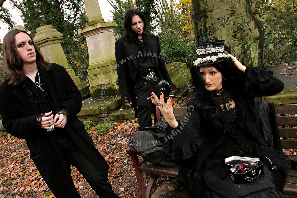 (left to right) Jonathan Aristow, 20, Darren Jack Powell, 36, both from London, and Audrey a 25-year-old French national getting ready for a cemetery tour organised by the Vampyre Connexion on Sunday, 2 December, 2006, in Nunhead Cemetery, South London, England. The Vampyre Connexion is the largest and most active of all the vampire groups in the United Kingdom, counting more than 100 members that for years have gathered regularly in London to share their common love for vampires and the Dark side of life. The Connexion raised from the hashes of the Vampyre Society, the first vampire appreciation group in 1995. The group believe in the fantasy of vampires and such creatures and live it to the full. Its  roots are to be found in the legends of Bram Stokerís Dracula. The group prints its own magazine, ëDark Nightsí featuring drawings, poetry, stories, photography and events. All of the members dress very peculiar clothing, and this is a very important part of the life of the group; it is respected with pride, taste and accuracy for the detail. Most like to dress to be elegant in a range of styles from regency to Victorian, some sew their own. In addition members visit art galleries, cemeteries, churches and cathedrals, attend gigs and concerts, and hold their own parties throughout the year, Halloween being the biggest and scariest one. Membership is open to all, the only qualification: being a love of all things Vampyric.   **ItalyOut**