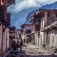 Stone buildings line the street of a village in the Kali Gandaki Valley, Nepal.