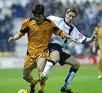 Photo: Dave Linney.<br />Derby County v Wolverhampton Wanderers. Coca Cola Championship. 18/11/2005.Seol( Wolves) is challenged by  Tommy Smith(Derby)