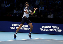 Pierre-Hugues Herbert plays a shot during his doubles match with team mate Nicolas Mahut against Horia Tecau and Jean-Julien Rojur during day one of the NITTO ATP World Tour Finals at the O2 Arena, London.