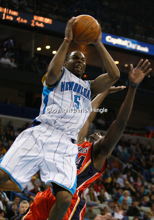 Mar 08, 2010; New Orleans, LA, USA; New Orleans Hornets guard Marcus Thornton (5) shoots over Golden State Warriors center Anthony Tolliver (44)during the second half at the New Orleans Arena. The Hornets defeated the Warriors 135-131. Mandatory Credit: Derick E. Hingle-US PRESSWIRE