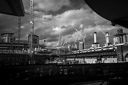 Construction site around Battersea Power Station. Cranes have become a symbol of London skyline, a costant presence that is evolving London cityscape.