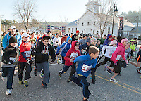 At the starting line with about 400 strong walkers and runners participated in Gilford Youth Center's annual 5k Turkey Trot Thursday morning.  (Karen Bobotas/for the Laconia Daily Sun)