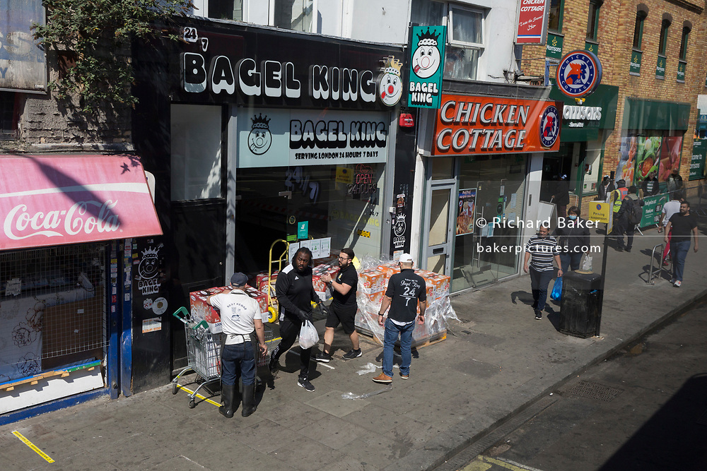As the UK's Coronavirus death toll during the government's social distancing lockdown, rose by 384 to 33,998, and the R rate of infection is reported to be between 0.7 and 1.0, south Londoners go about their business on the Walworth Road in Southwark, on 15th May 2020, in London, England.