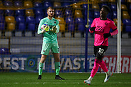 AFC Wimbledon goalkeeper Connal Trueman (1) holding onto ball wiuth hand out during the EFL Sky Bet League 1 match between AFC Wimbledon and Peterborough United at Plough Lane, London, United Kingdom on 2 December 2020.
