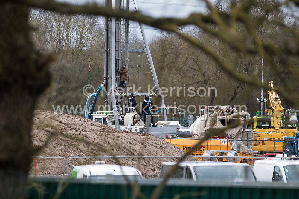 Harefield, UK. 18 February, 2020. One of two environmental activists who locked onto a drilling rig at a HS2 high-speed rail site in the Colne Valley. Another activist, partially-sighted former Paralympic cyclist James Brown, was removed shortly before by National Eviction Team bailiffs. Activists from Stop HS2, Save the Colne Valley and Extinction Rebellion argue that HS2 intend to use the rig to drill into the aquifer which supplies 22% of London's drinking water, risking contamination.