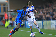 Joe Bunney is challenged by Leonardo da Silva Lopes during the EFL Sky Bet League 1 match between Gillingham and Rochdale at the MEMS Priestfield Stadium, Gillingham, England on 30 March 2019.