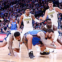 09 November 2017: Oklahoma City Thunder center Steven Adams (12) vies for the ball with Denver Nuggets forward Paul Millsap (4) and Denver Nuggets forward Wilson Chandler (21) during the Denver Nuggets 102-94 victory over the Oklahoma City Thunder, at the Pepsi Center, Denver, Colorado, USA.