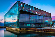 Harpa is a concert hall and conference centre in Reykjavík, Iceland. The opening concert was held on May 4, 2011. The building features a distinctive colored glass facade inspired by the basalt landscape of Iceland.