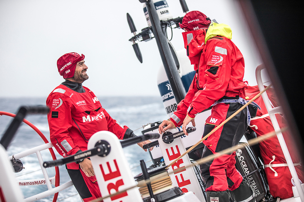 Leg 02, Lisbon to Cape Town, day 18, on board MAPFRE, Xabi Fernandez talking with Sophie Ciszek while they are grinding. Photo by Ugo Fonolla/Volvo Ocean Race. 22 November, 2017