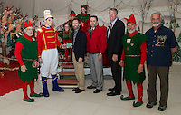 The Christmas Village Mayor for 2013 Jack Johnston hands the key to Laconia's Mayor Michael Seymour with Tinsel (far left) Ed Engler, Scott Myers and Twinkle to declare the Christmas Village officially open Thursday evening.  (Karen Bobotas/for the Laconia Daily Sun)