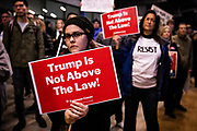"""SAN FRANCISCO, CA - DECEMBER 17: Shalynn Ehrenpfort of San Francisco, California looks on during demonstrations in part of a national impeachment rally, at the San Francisco Federal Building in San Francisco, California on December 17, 2019. Protesters around the nation participated in """"Nobody is Above the Law"""" rallies on the eve of a historic Trump impeachment vote in the United States House of Representatives. The crowd size at the San Francisco event is approximated in the several hundreds. (Photo by Philip Pacheco/AFP)"""