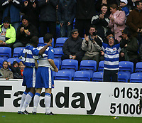 Photo: Jo Caird<br /> Reading v Derby<br /> Madejski Stadium<br /> Nationwide Div 1 2004<br /> 31/01/2004.<br /> <br /> Shaun Goater's goal is celebrates by Adie Williams and a young fan