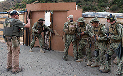 AZUSA, Calif. (May 21, 2017) Sailors assigned to Fleet Combat Camera Pacific (FCCP) prepare to enter a mock compound during close quarters battle training at FCCP's Summer Quick Shot Exercise 2017 in Azusa, Calif. Quick Shot is a biannual exercise that provides live-fire and scenario based training to combined joint combat camera assets. (U.S. Navy Combat Camera photo by Mass Communication Specialist 2nd Class Antonio Turretto Ramos/Released)170521-N-DC018-020<br />Join the conversation:<br />http://www.navy.mil/viewGallery.asp<br />http://www.facebook.com/USNavy<br />http://www.twitter.com/USNavy<br />http://navylive.dodlive.mil<br />http://pinterest.com<br />https://plus.google.com