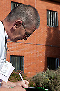 A prisoner studying in the grounds of the prison. HMP The Mount, Bovingdon, Hertfordshire