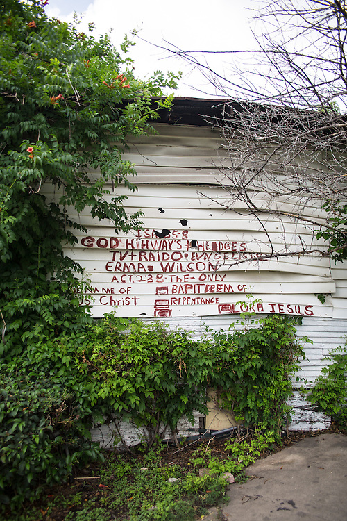 Handpainted religious message on the side of an  blighted abandoned home in San Antonio Texas