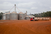 Silos for grain storage with a truck in front, on a large soya and maize farm. Brazil is the largest producer of Sugar and Beef, then second for Soya and third for Maize. Many of the farms are in the state of Mato Grosso and Mato Grosso do Sul, they are often enournmous, stretching for miles kilometres. A lot of the crops are processed on site and kept in large warehouses or silos.