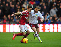 Nottingham Forest's Jamie Paterson shields the ball from Burnley's Kieran Trippier <br /> <br /> Photo by Chris Vaughan/CameraSport<br /> <br /> Football - The Football League Sky Bet Championship - Nottingham Forest v Burnley - Saturday 23rd November 2013 - The City Ground - Nottingham<br /> <br /> © CameraSport - 43 Linden Ave. Countesthorpe. Leicester. England. LE8 5PG - Tel: +44 (0) 116 277 4147 - admin@camerasport.com - www.camerasport.com