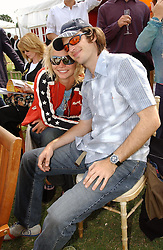 Model JODIE KIDD and AYDEN BUTLER at the Veuve Clicquot sponsored Gold Cup or the British Open Polo Championship won by The  Azzura polo team who beat The Dubai polo team 17-9 at Cowdray Park, West Sussex on 18th July 2004.