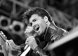 File photo dated 28/06/86 of George Michael on stage for Wham's last sell out concert at Wembley Stadium in London, as the pop superstar has died peacefully at home, his publicist said.