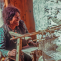 A woman works at a homemade loom in Muktinath, Nepal.