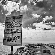 Posted sign warns that bathing in Manila Bay is dangerous to your health and swimmers will be forcefully prohibited from entering the water.