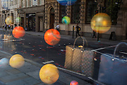 Reflections of bags and spheres representing the planets on 13th September 2016, in the City of London, England.