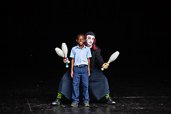 """""""Dash"""" of Aga-Boom shows 3rd grade Yvonne Bowsky student LeAndre Finley how to juggle.  Aga-Boom performs at the Reichhold Center for the Arts on saturday night at 7pm.  Reichhold Center Family Series with the international comedy clown troupe Aga-Boom.  Reichhold Center.  9 November 2012.  © Aisha-Zakiya Boyd"""